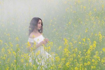lady walking among flowers
