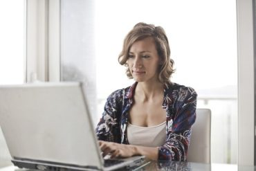 woman doing surveys from computer
